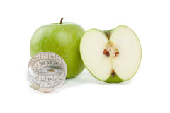 Picture of apples and tape measure Stock Images