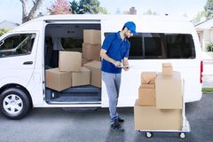 Italian courier is checking package in the road Stock Image