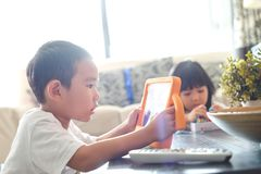 Boy playing online games on tablet royalty free stock photos