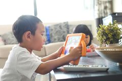 Boy playing online games on tablet royalty free stock photo