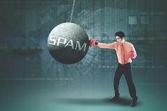 Asian businessman punching spam word Stock Images