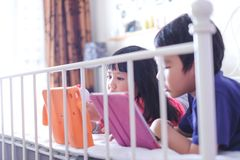 Kids watching online video on tablet stock image