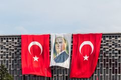 Picture of Ataturk stands between Turkish Flags stock images