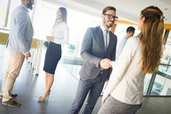 Picture of business colleagues talking in office. Picture of attractive business colleagues talking in office royalty free stock photography