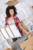 Picture attractive female with cardboard box Stock Photography