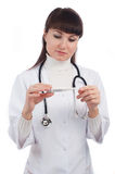 Female doctor with thermometer Stock Images