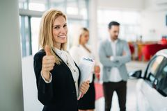 Picture of attractive saleswoman working in company. Picture of attractive smiling saleswoman working in company stock photos