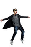 Picture of attractive young man in sunglasses dancing over white Royalty Free Stock Photography