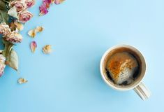 Picture of autumn background with dry roses and cup of coffee wi Stock Image
