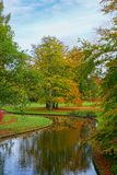 Picture of autumn park with red and yellow trees and lake in the Copenhagen, Denmark. Picture of autumn park with red and yellow trees and lake in the Copenhagen royalty free stock image