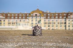 Picture of a beach bag with toys in Normandy symbolizing a week-end at the sea in France. Royalty Free Stock Photos