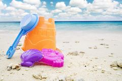 Beach toys in the tropical beach. Picture of beach toys with beautiful blue sky background . Shot in the tropical beach Stock Photography