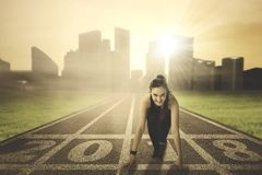 Arabian woman kneeling on the track royalty free stock images