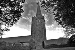 West wales church with dark clouds stock images