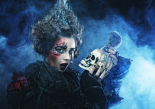 Picture a beautiful fantasy woman with skull. Halloween theme. Royalty Free Stock Images