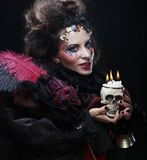 Picture a beautiful fantasy woman with skull. Halloween theme. Royalty Free Stock Photography
