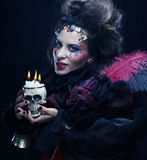 Picture a beautiful fantasy woman with skull. Halloween theme. Royalty Free Stock Photo