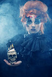 Picture a beautiful fantasy woman with skull. Stock Photography