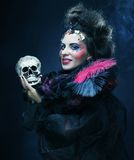 Picture a beautiful fantasy woman with skull. Royalty Free Stock Images