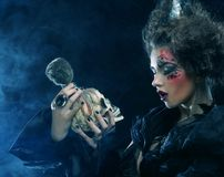Picture a beautiful fantasy woman with skull. Stock Photos