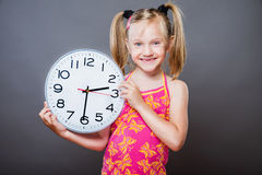 Picture of beautiful girl with big clock Stock Image