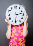 Picture of beautiful girl with big clock Stock Photography
