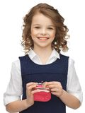 Girl with coin purse Stock Photos