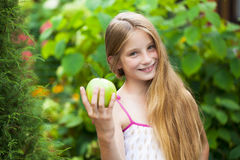 Picture of beautiful girl with green apple Royalty Free Stock Photo