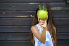Picture of beautiful girl with green apple Royalty Free Stock Photography