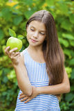 Picture of beautiful girl with green apple Royalty Free Stock Photos