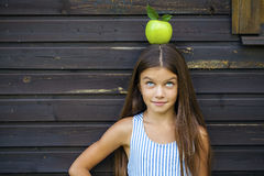 Picture of beautiful girl with green apple Royalty Free Stock Image