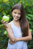 Picture of beautiful girl with green apple Stock Photo