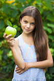 Picture of beautiful girl with green apple Stock Image