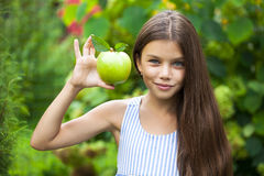 Picture of beautiful girl with green apple Stock Photos