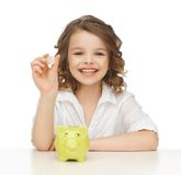 Girl with piggy bank Royalty Free Stock Photo