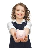 Girl with piggy bank Royalty Free Stock Images