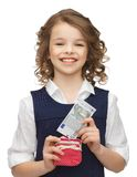 Girl with purse and paper money Stock Photography
