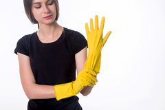 Picture of beautiful housewife with yellow protective gloves. Isolated on white Royalty Free Stock Images