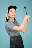 Picture of beautiful pin up woman with hammer Royalty Free Stock Photos