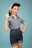 Picture of beautiful pin up woman with tool Stock Photography