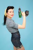 Picture of beautiful pin up woman with tool Stock Image