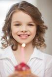 Girl with cupcake Stock Photo
