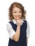 Pre-teen girl showing hush gesture Royalty Free Stock Photo