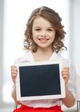 Girl with tablet pc. Picture of beautiful pre-teen girl with tablet pc Royalty Free Stock Image
