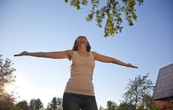 Picture of beautiful relaxed woman standing and looking up in th royalty free stock photography