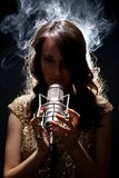 Picture of beautiful singer with studio microphone Royalty Free Stock Photography