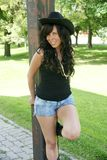 Smilling cowgirl. Picture of beautiful smilling cowgirl with black hat royalty free stock images