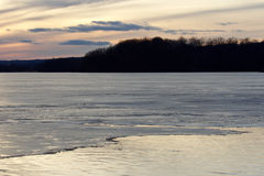 Picture with a beautiful sunset on the icy lake Royalty Free Stock Images
