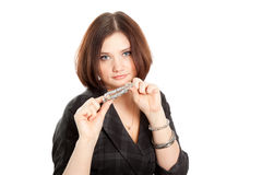 Picture of beautiful woman in black dress holding a bracelet Royalty Free Stock Photography