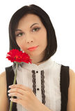 Picture of beautiful woman with red flower Royalty Free Stock Image